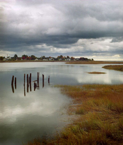 stormy-clouds-still-water.jpg